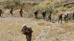 Vikosi vya usalam vya Iraq kiendesha operesheni dhidi ya kundi la Islamic State katika kijiji cha mkoa wa Diyala, Novemba 13.