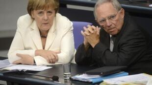 Angela Merkel y el ministro de Finanzas Wolfgang Schäuble.