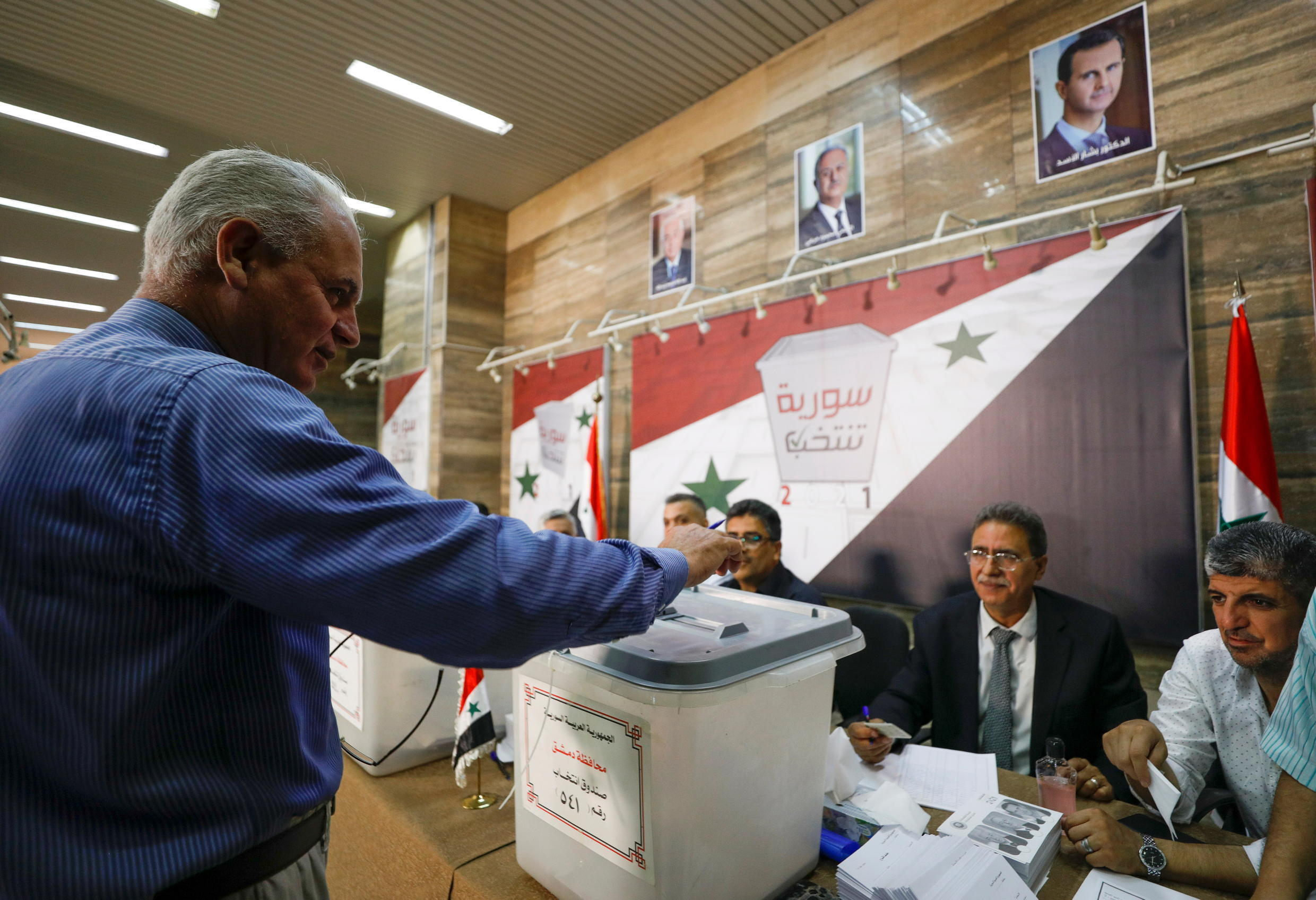 2021-05-26T052445Z_2064151218_RC2HNN9M6L0O_RTRMADP_3_SYRIA-SECURITY-ELECTION