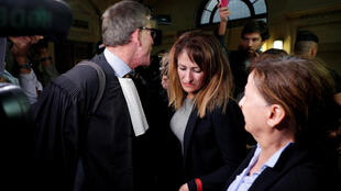 Nathalie Haddadi (centre), whose radicalised son fought in Syria where he allegedly died as a jihadist, and her lawyer Herve Denis leave the criminal court after the verdict in the trial where she is accused of aiding and financing terrorism.