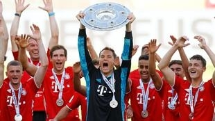 Bayern Munich skipper Manuel Neuer brandishes a record-extending 30th top flight title for the club.