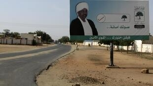Sudanese President Al-Bashir is seen on a billboard in El Fasher, 8 October