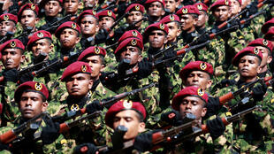 Sri Lankan commandos march in a parade one year after defeating the Tamil Tigers