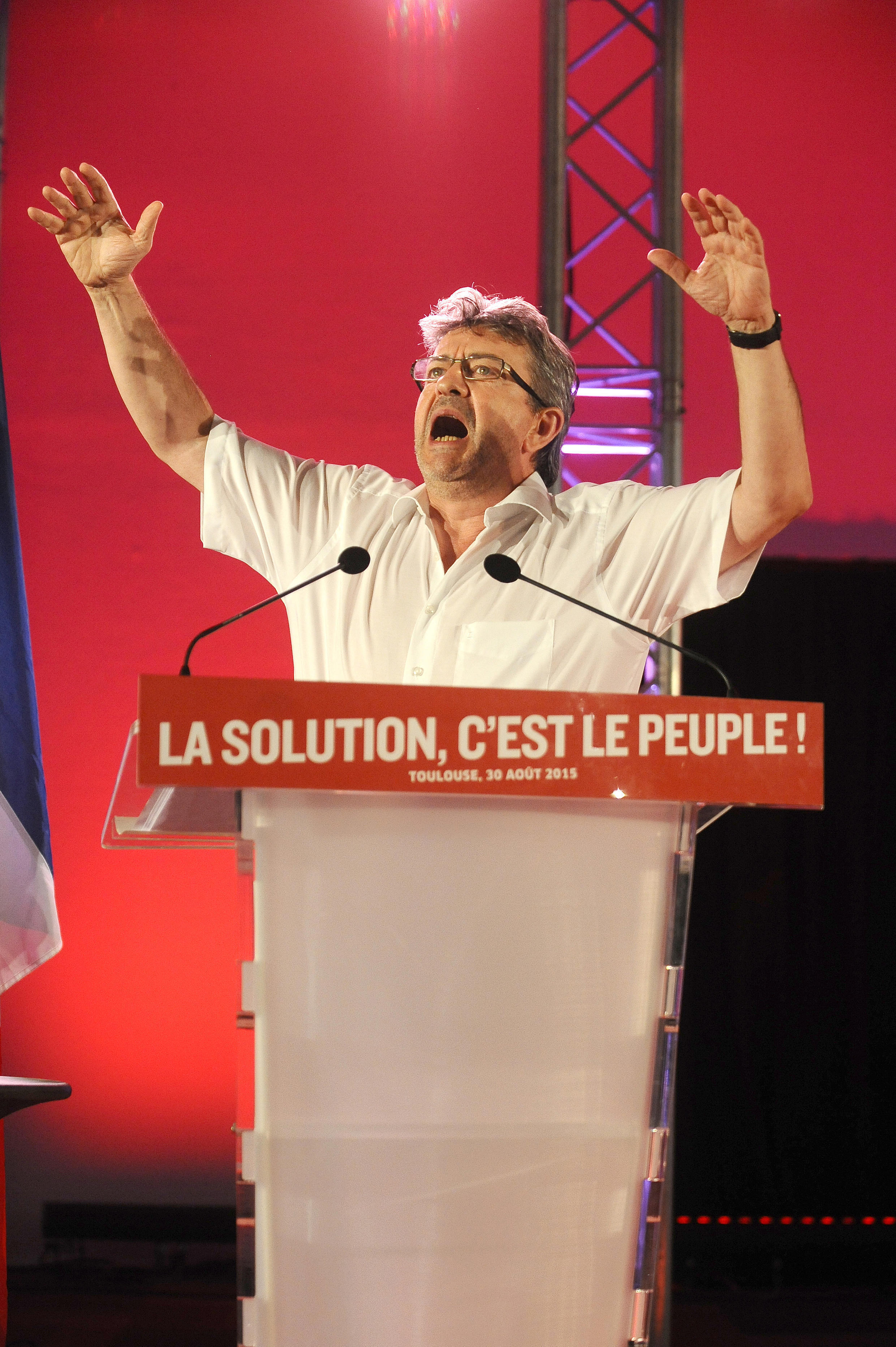 French member of the European parliament and Left Front (Front de Gauche, FG) President Jean-Luc Melenchon gestures as he delivers a speech during the Left Party (Parti de Gauche, PG) summer university in Toulouse on August 30, 2015