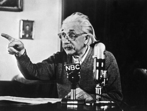 """(FILES) In this file photo taken on February 14, 1950 German-born Swiss-US physicist Albert Einstein, author of the theory of relativity, declares his opposition to the """"H"""" bomb and to the arms race between the USA and the USSR in a conference in Princeton during a TV broadcast which created a considerable stir in the United States and all over the Western World. A handwritten letter from Albert Einstein about his thoughts on God, religion and his search for meaning is to go on sale in New York, valued at up to $1.5 million, Christie's said October 3, 2018. Written a year before the legendary physicist died in 1955, his name synonymous with genius, Einstein writes in German from Princeton, New Jersey to German philosopher Eric Gutkind.""""The word God is for me nothing but the expression and product of human weaknesses, the Bible a collection of venerable but still rather primitive legends,"""" writes the physicist, best known for his theory of relativity."""