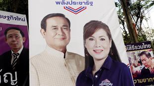 Prime Minister Prayuth Chan-ocha is seen next to a candidate of Palang Pracharat party on an election campaign poster in Bangkok, Thailand, March 9, 2019. Picture taken March 9, 2019.