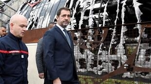 French Interior Minister Christophe Castaner visits the wreckage of the circus school at Chanteloup-les-Vignes, which was burned in urban violence at the weekend, on 5 November 2019.
