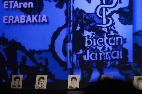 Eta members' photos displayed in front of the group's logo at a meeting in Guernica last June