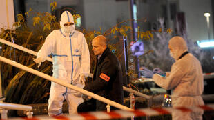 Forensic experts on the scene of a knife attack on police officers in Joué-les-Tours, central France