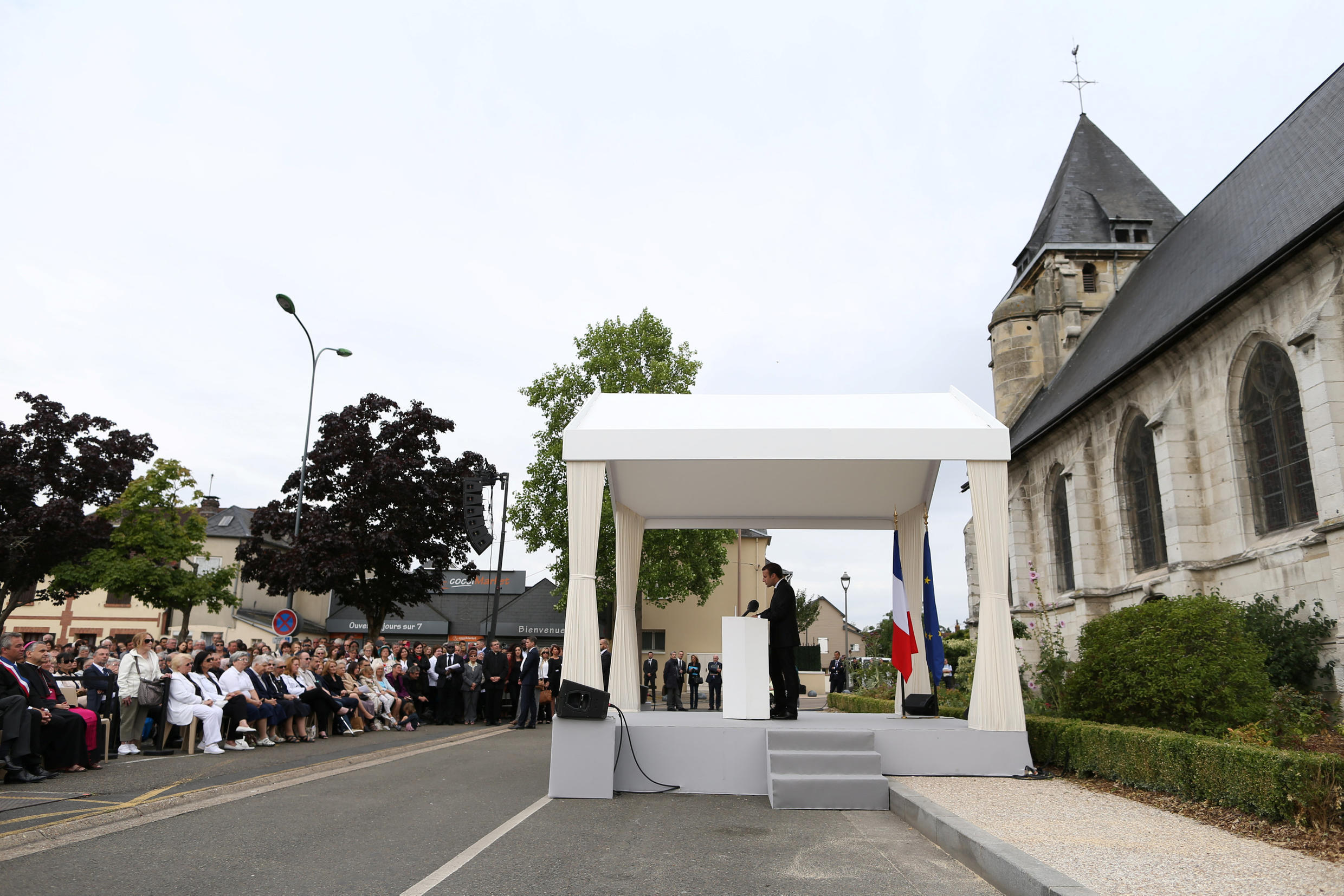 French President Emmanuel Macron delivers a speech after a mass to pay tribute to French priest Father Jacques Hamel one year after he was killed by Islamist militants in an attack in the church, in Saint-Etienne-du-Rouvray, France, July 26, 2017.