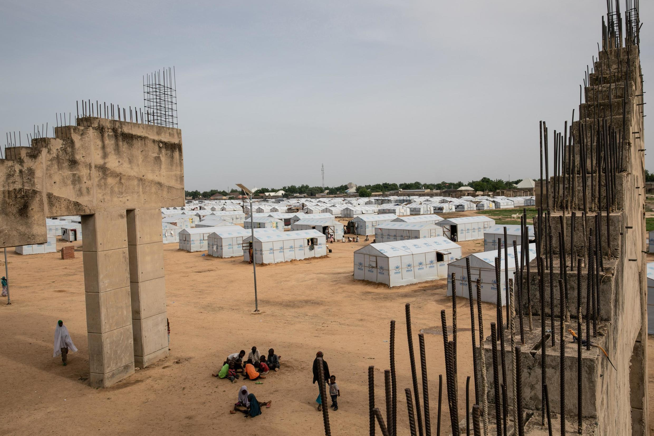 Some two million people have been uprooted from their homes since the Boko Haram insurgency in Nigeria started 10 years ago. Many now survive in displaced camps such as this one at the unfinished Mohammed Goni Stadium in Maiduguri. 26th July 2019.