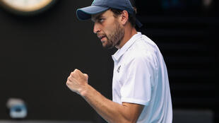 Aslan Karatsev celebrates after beating Grigor Dimitrov to become the first Slam debutant to make a semi-final at the Australian Open