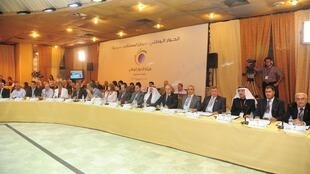 Representatives of independent groups take part in a two-day national dialogue in Damascus 10 July 2011.