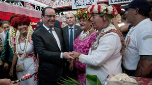 French President François Hollande visits the market in Papeete on Monday
