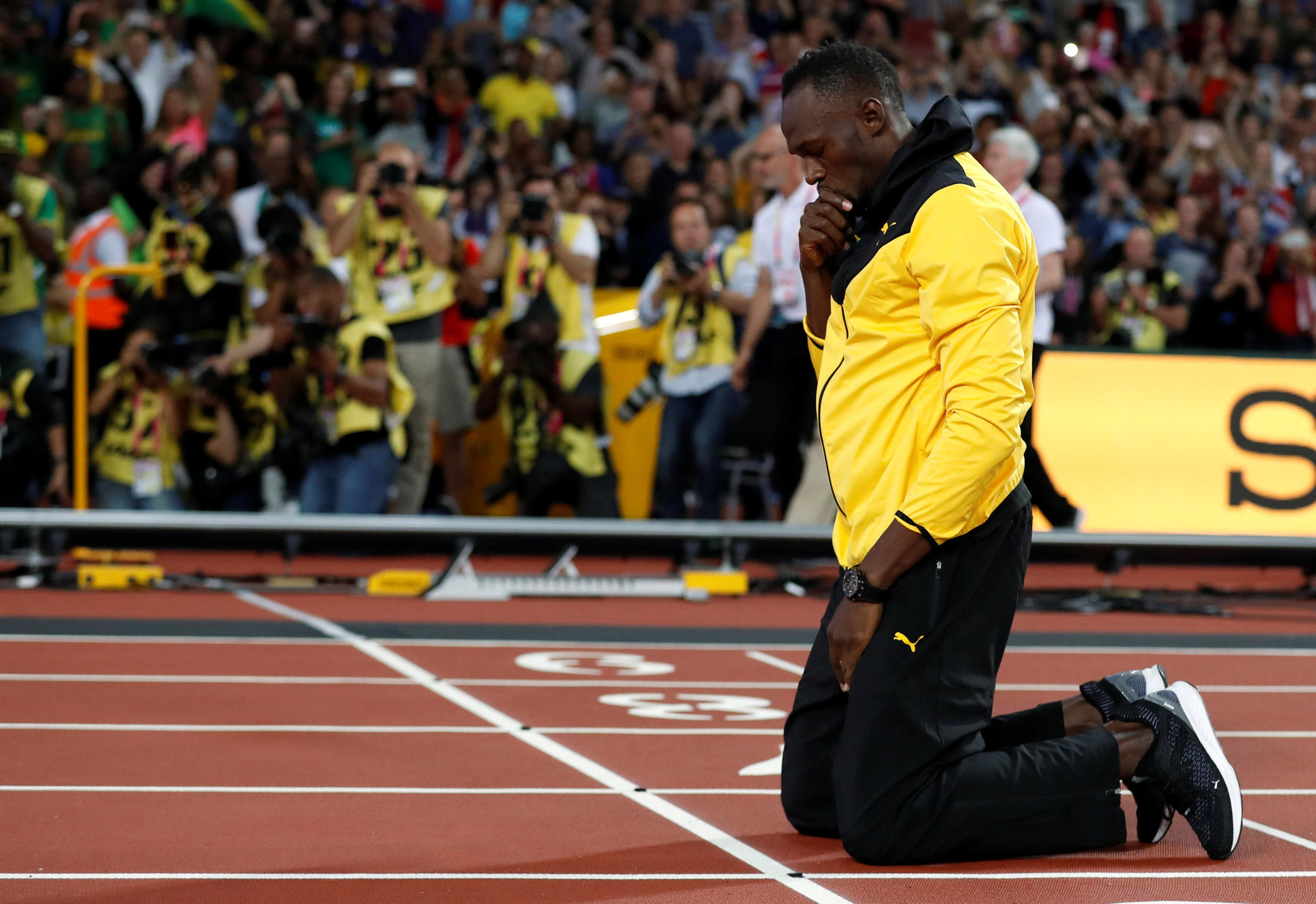 Usain Bolt paused at memorable points on the track at the Olympic stadium in London.