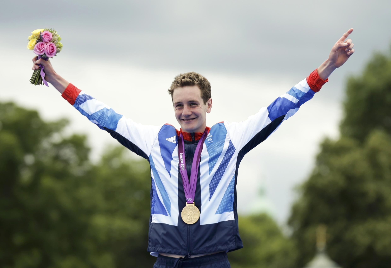 Britain's Alistair Brownlee celebrates his gold medal