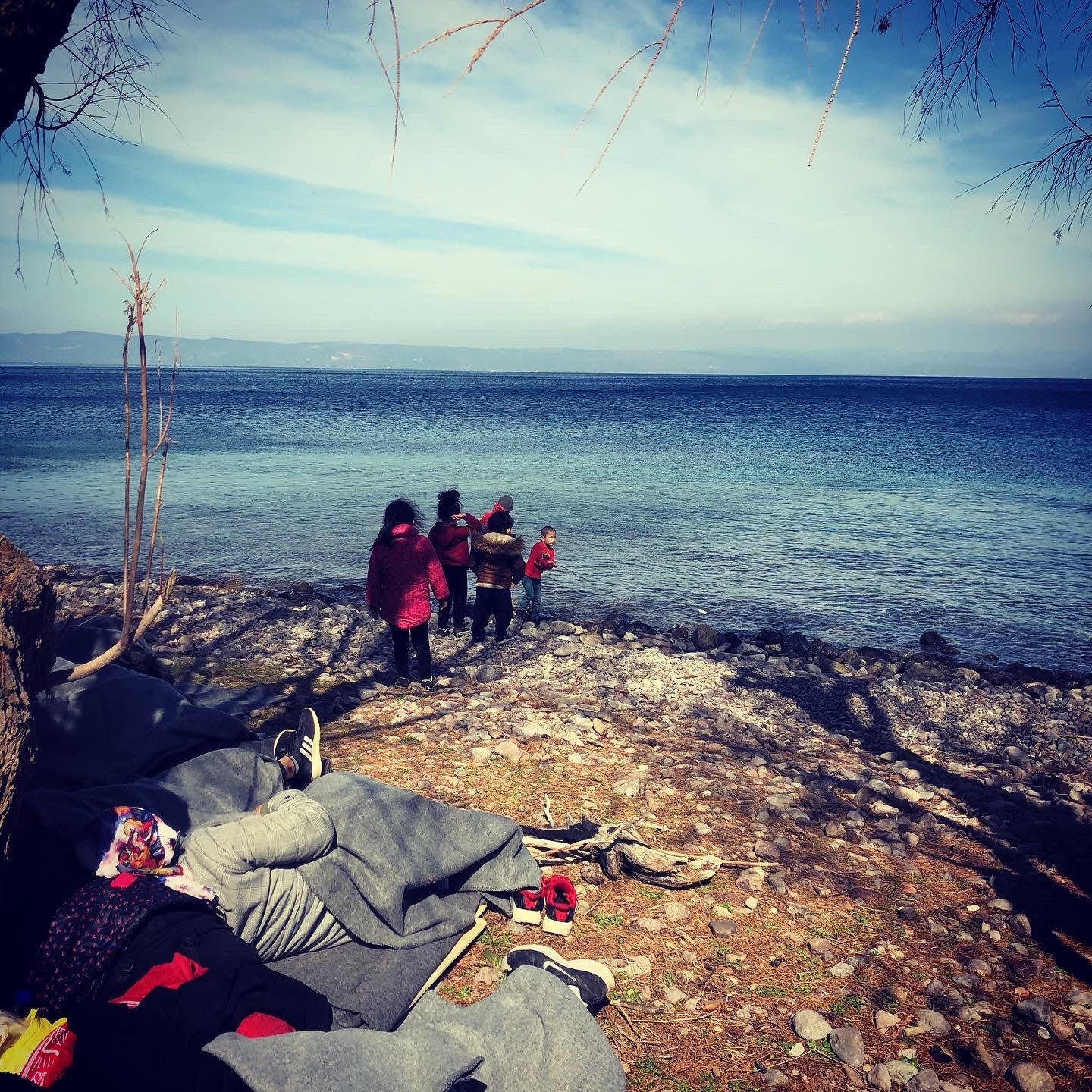 Migrants gather on the island of Lesbos, Greece, March 2020