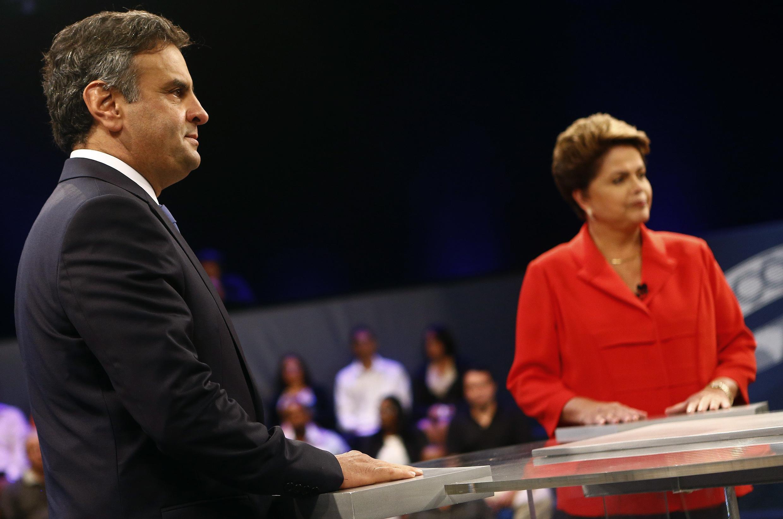 លោក Aecio Neves និងលោកស្រី  Dilma Rousseff ក្នុងពេលវេទិកាជជែកតទល់គ្នានៅ ក្នុងកម្មវិធីទូរទស្សន៍ប្រេស៊ីល ថ្ងៃទី ២៤ តុលា ២០១៤