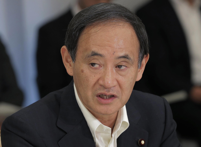 """Theo phát ngôn viên chính phủ Nhật Yoshihide Suga : Vụ tàu Trung Quốc đâm chìm tàu cá Việt Nam trên Biển Đông là """"một hành động cực kỳ nguy hiểm"""" - REUTERS /Itsuo Inouye"""