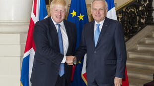 French Foreign Minister Jean Marc Ayrault with Britain's Foreign Minister Boris Johnson meet at the Ministry in Paris.