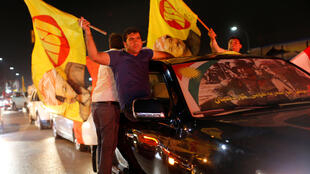 Kurds in the city of Erbil celebrate on 25 September 2017 following an independence vote across Iraqi Kurdistan.