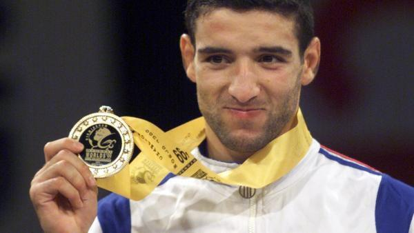 Larbi Benboudaoud and his gold medal at the Birmingham World Championships in 1999.