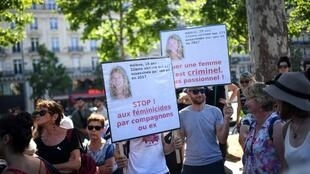 Protestors hold placards during a demonstration against violences against women and to demand immediate measures and increased resources to fight against feminicide, in Paris, on July 6, 2019