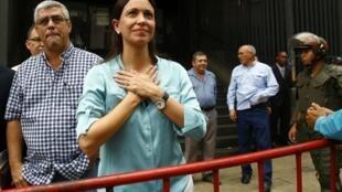 Venezuela's opposition leader Maria Corina Machado arrives to state prosecutor office in Caracas, 3 December 2014.