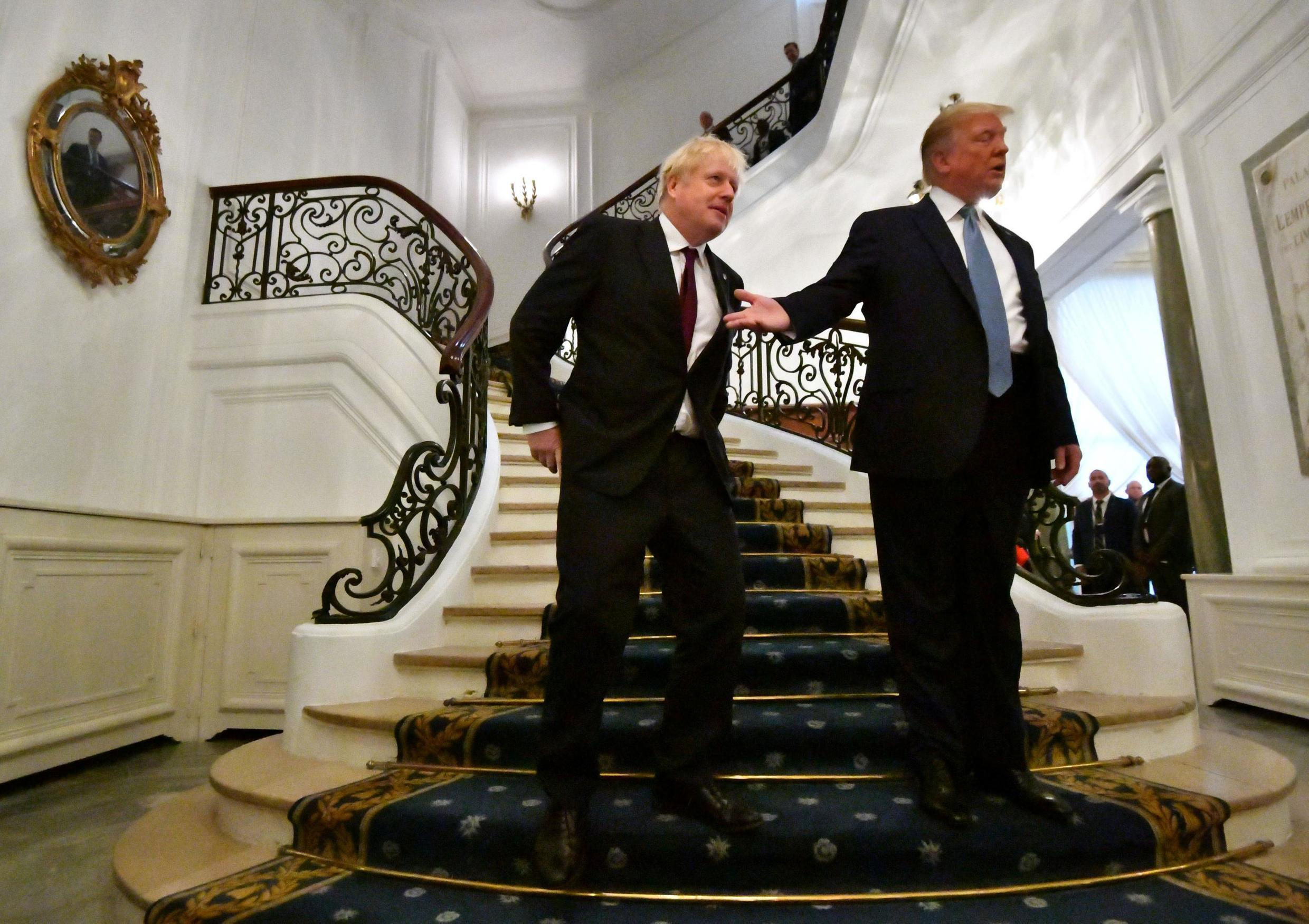 U.S. President Donald Trump and Britain's Prime Minister Boris Johnson arrive for a bilateral meeting during the G7 summit in Biarritz, France, 25 August, 2019.