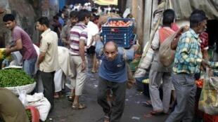 Sur un marché aux légumes à New Delhi, le 21 août 2013.