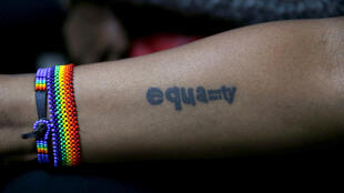 Tattoo of a LGBT activist is seen during a court hearing in Kenya's High Court in Nairobi
