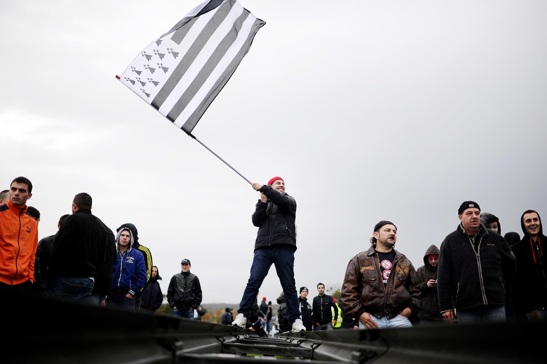 A demonstrator waves a Breton flag at Montauban-de-Bretagneon Saturday