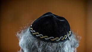 "A Jewish man wears a kippa, or Jewish religious skull cap, during a meeting on ""the German and French perspectives on immigration, integration and identity"" organised by the American Jewish Committee (AJC) on April 24, 2018 in Berlin."
