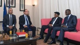 President François Hollande, with Overseas Territories Minister Victorin Lurel (L) meets Etienne Tshisekedi (centre right) UDPS member, Albert Moleka