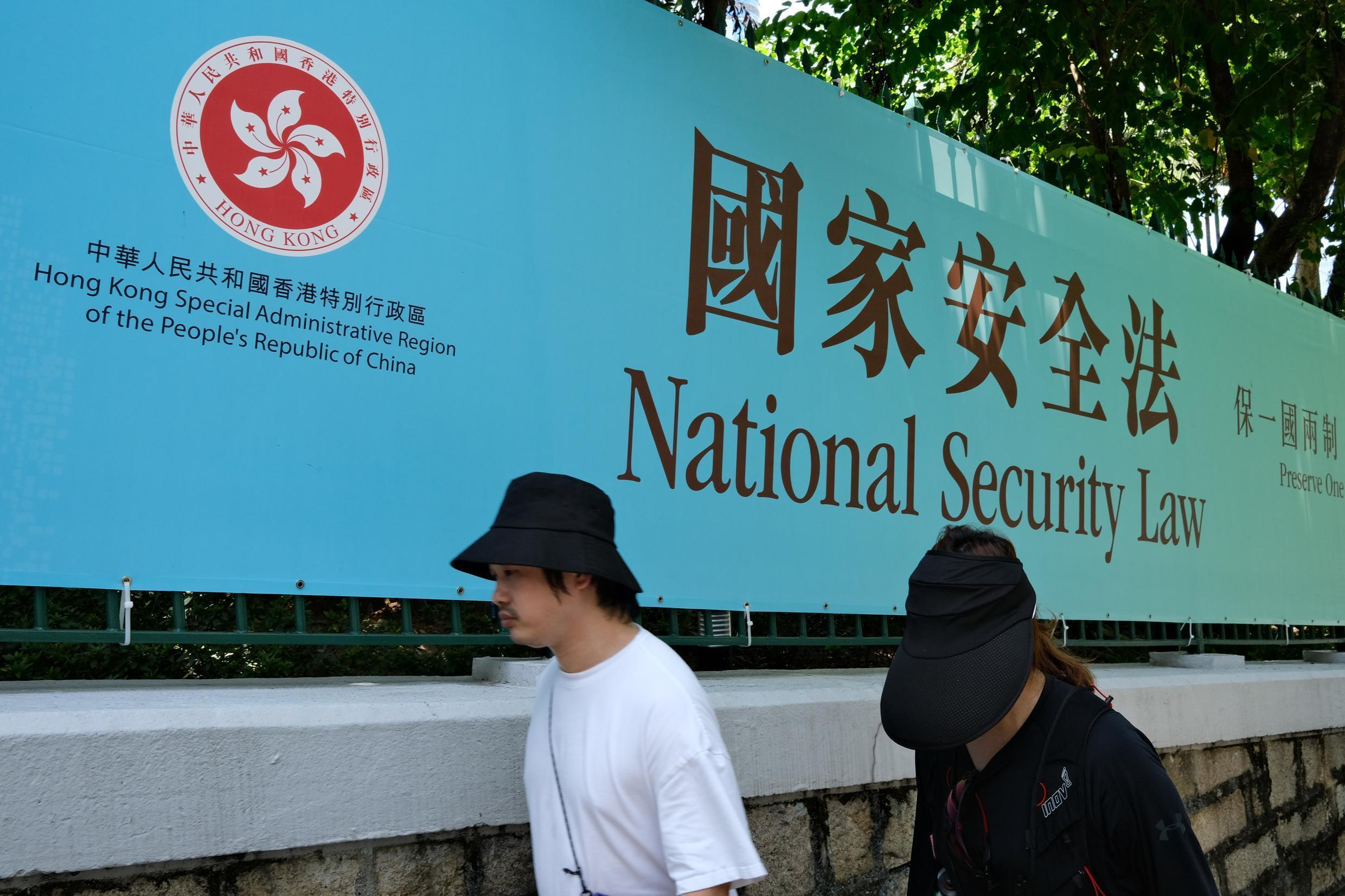 Dozens of people were arrested in a morning sweep of democracy activists in Hong Kong