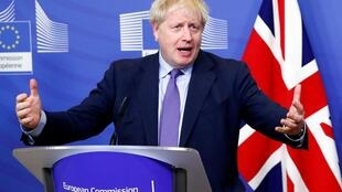 Britain's Prime Minister Boris Johnson gestures during a news conference with European Commission President Jean-Claude Juncker after agreeing on the Brexit deal, at the sidelines of the European Union leaders summit, in Brussels, Belgium October 17, 2019.