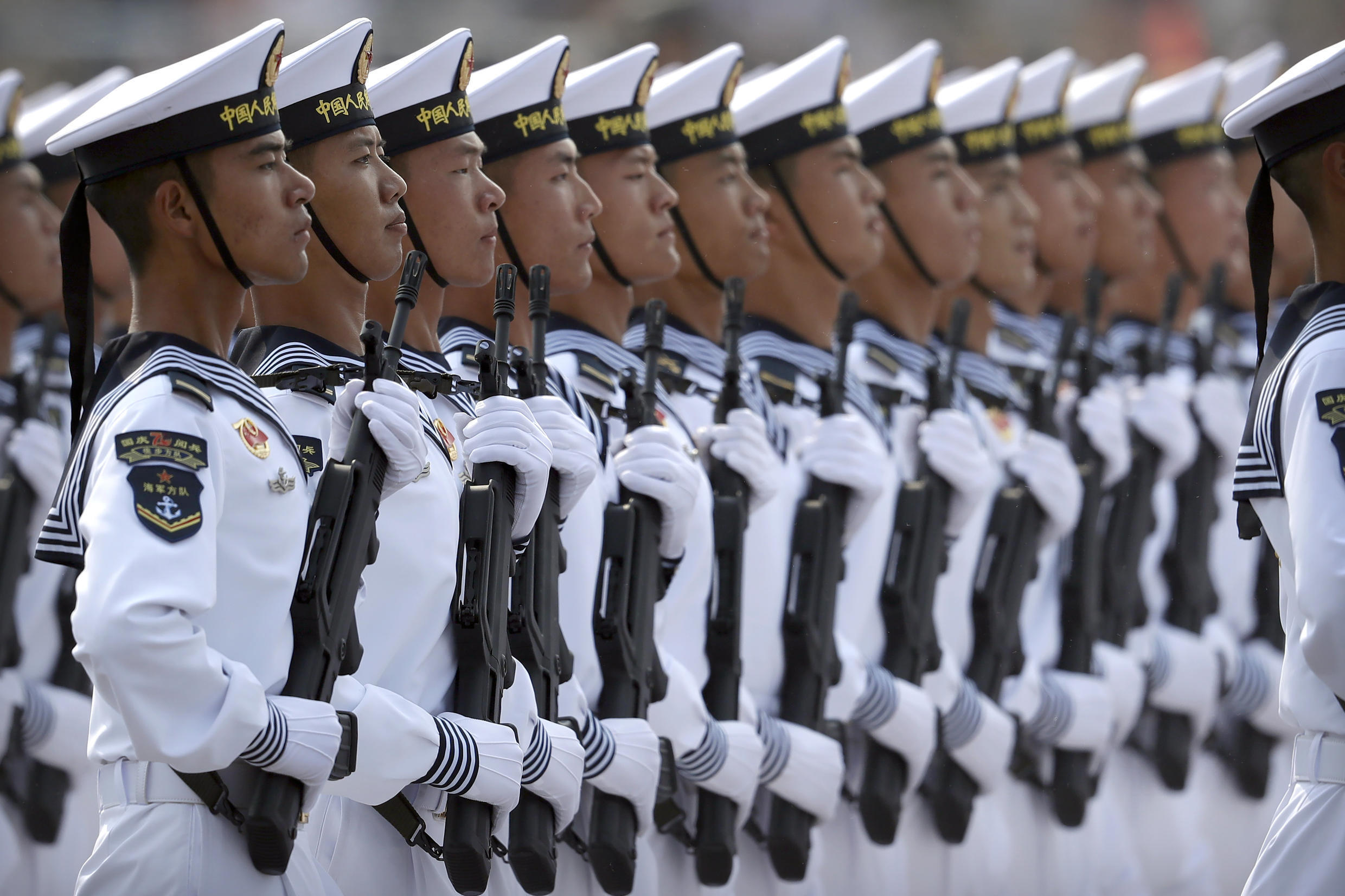 Soldiers from China's People's Liberation Army (PLA) Navy march in formation during a parade to commemorate the 70th anniversary of the founding of Communist China in Beijing, Tuesday, Oct. 1, 2019. Trucks carrying weapons including a nuclear-armed missile designed to evade U.S. defenses rumbled through Beijing as the Communist Party celebrated its 70th anniversary in power with a parade Tuesday that showcased China's ambition as a rising global force.