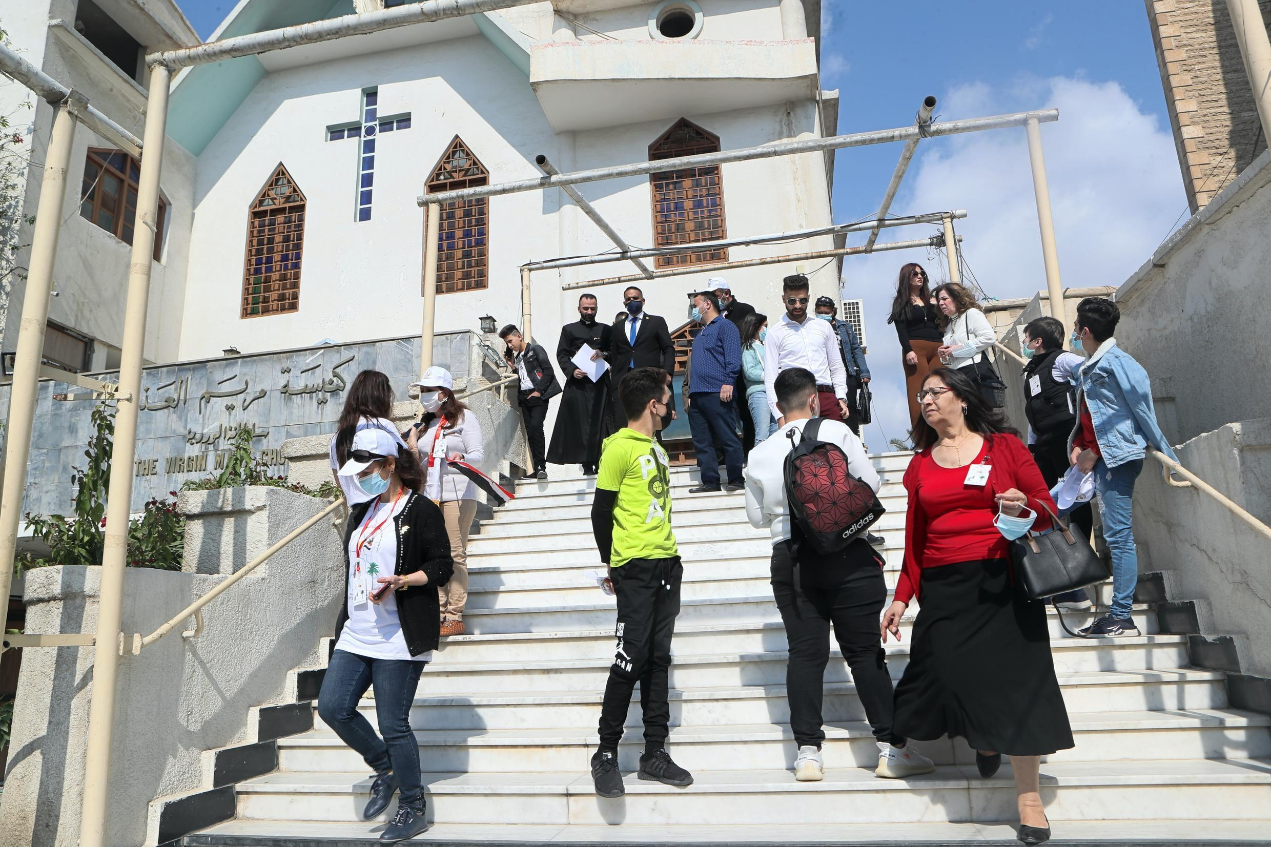 Iraqi Christians gather at the Church of the Virgin Mary before going to the airport to welcome the Pope in Baghdad Iraq Friday