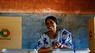 Zimbabwe's first lady Auxilia Mnangagwa casts her vote as she accompanies her husband at the Sherwood Primary School in Kwekwe, central Zimbabwe on July 30, 2018.