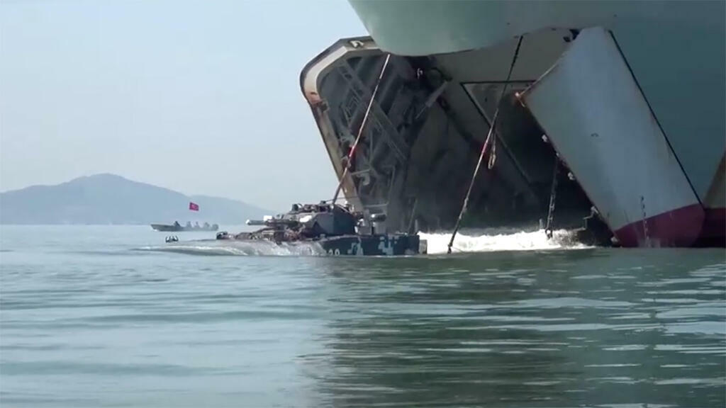 An amphibious tank being released from a landing vessel shown in a film that was attended by Chinese President Xi Jinping when he visited the PLA Navy base at Chaozhou Port in Shantou, 13 October 2020.