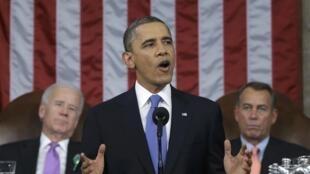 Barack Obama entouré de Joe Biden (gauche) et de John Boehner lors de son discours sur l'Etat de l'Union à Washington le 12 février.