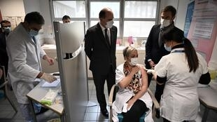 French Prime Minister Jean Castex (centre) and French Health Minister Olivier Veran (right) visit a vaccination center in Tarbes, southwestern France, on January 9, 2021.