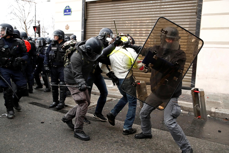 Police arrest a protester in Paris on December 8.