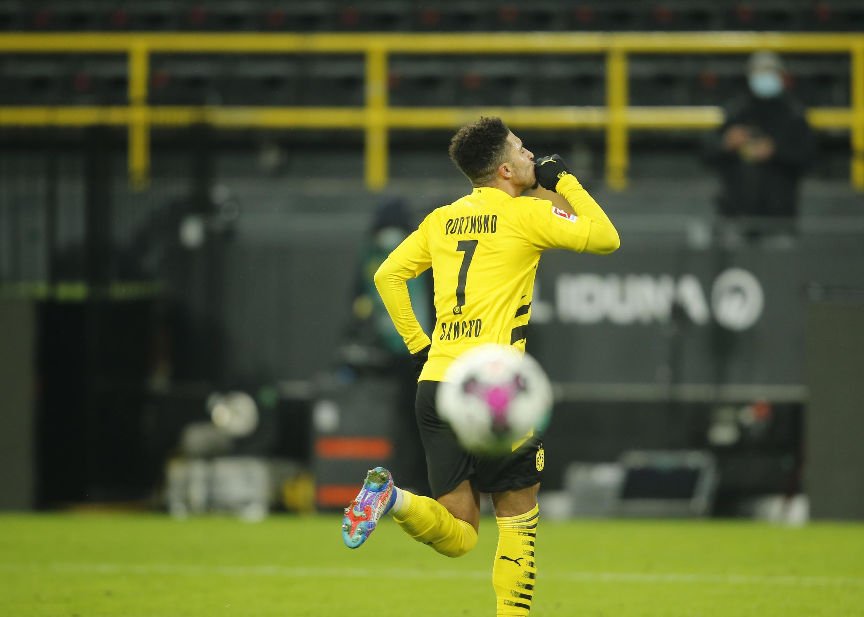 Dortmund winger Jadon Sancho celebrates scoring in Sunday's 2-0 win over Wolfsburg