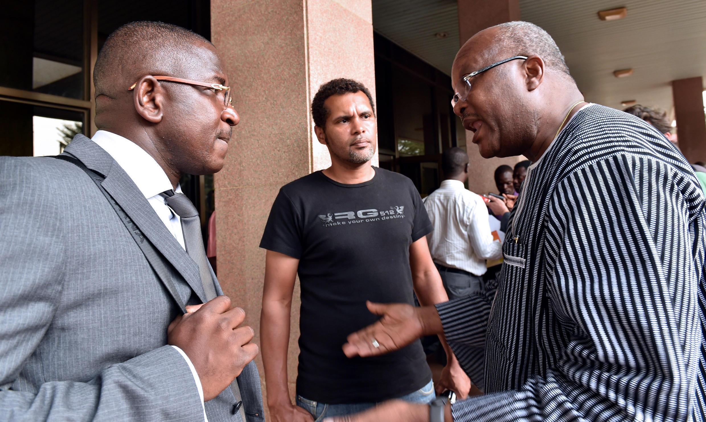 Roch Marc Christian Kabore, ancien président du Parlement, et Guy Herve Kam, l'avocat du mouvement «balai citoyen», le 12 novembre à Ouagadougou.