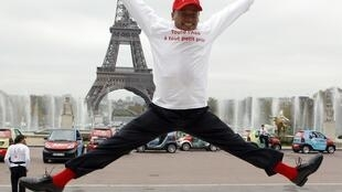 AirAsia X CEO Azran Osman-Rani jumps in front of the Eiffel Tower at the launch of the Kwala Lumpur - Paris route