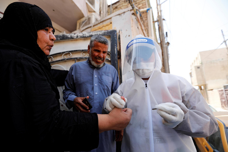 Wasu al'ummar Iraqi karkashin matakan yaki da coronavirus.