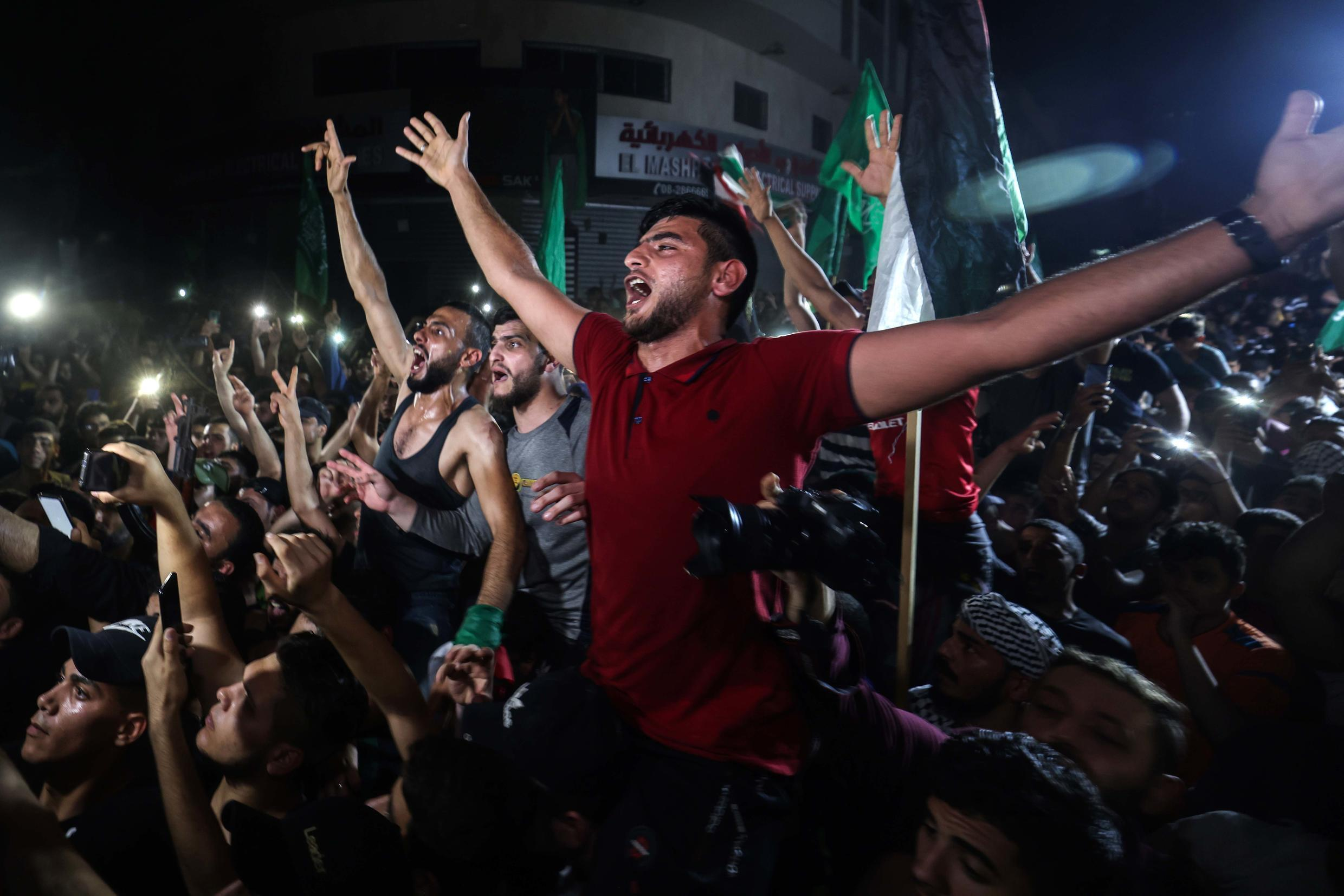Gazans take to the streets to celebrate following a ceasefire brokered by Egypt between Israel and the ruling Islamist movement Hamas