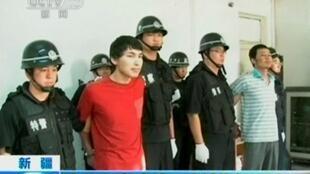 Các bị cáo bị kết án tử hình tại vùng Tân Cương ngày 16/06/2014.
