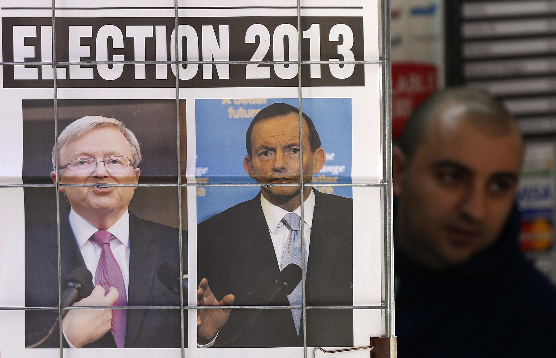 Bango la kampeni ya uchaguzi wa Septemba 7, 2013 waziri mkuu Kevin Rudd (kushoto) na kiongozi wa upinzani Tony Abbott (Kulia).